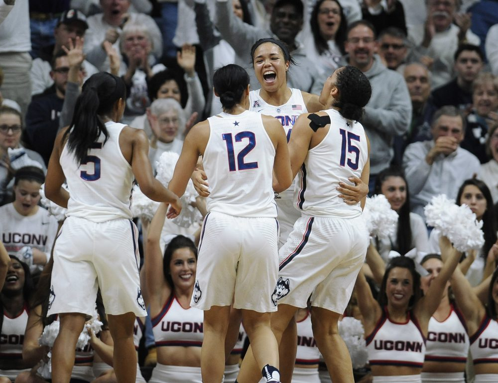 Connecticut's Napheesa Collier, center, celebrates with teammates Crystal Dangerfield, left, Saniya Chong, and Gabby Williams, right, after beating South Carolina 66-55. (Jessica Hill/AP)