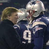 As some teammates decide to boycott the White House visit, Tom Brady remains silent on politics, writes Andrew Bauld. For the sake of his off-field legacy, Brady should speak up. Pictured here: Donald Trump talks to New England Patriots quarterback Tom Brady prior to the start of a 2004 AFC playoff game against the Titans at Gillette Stadium. (Elise Amendola/AP)