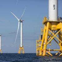 Three wind turbines from the Deepwater Wind project off Block Island, R.I. (Michael Dwyer/AP)