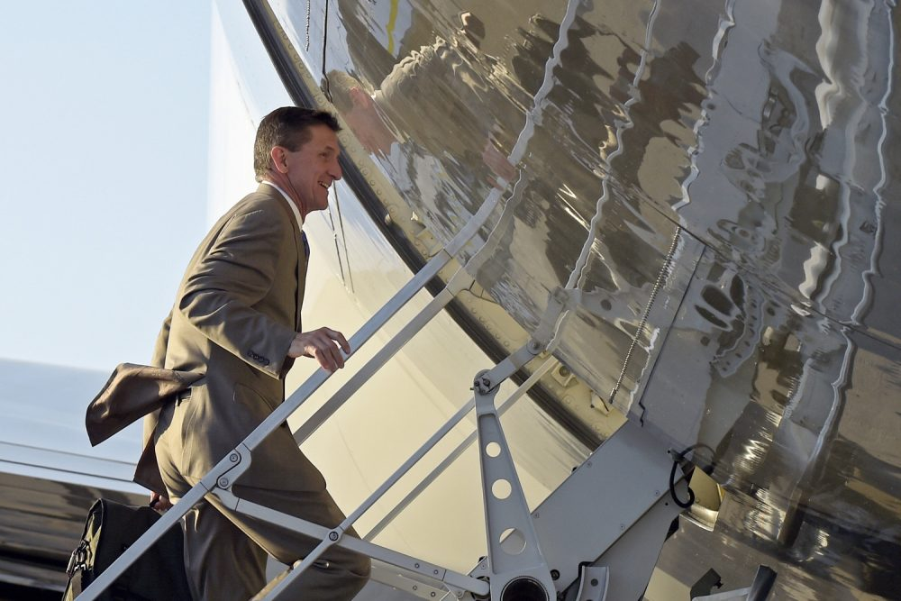 In this Feb. 12, 2017, photo, former National Security Adviser Michael Flynn boards Air Force One at Palm Beach International Airport in West Palm Beach, Fla., as he return to Washington with President Donald Trump. (Susan Walsh/AP)