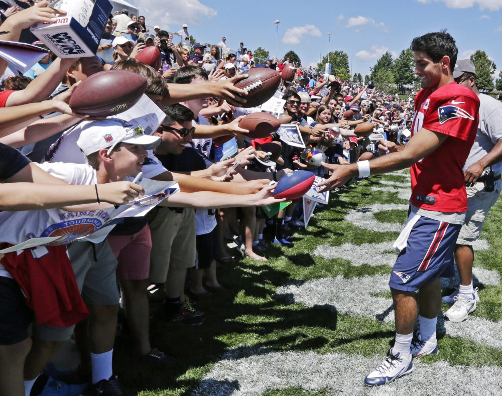 New England Patriots quarterback Jimmy Garappolo signs autographs for fans during training camp in Foxborough in 2015. (Charles Krupa/AP)