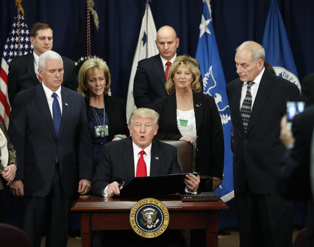 International leaders are taking Trump seriously, writes Susan E. Reed. This time, he has to stay in his lane. Pictured: President Donald Trump, accompanied by Vice President Mike Pence, Homeland Security Secretary John F. Kelly, and others, during a visit to the Homeland Security Department on Wednesday, Jan. 25. (Pablo Martinez Monsivais/AP)