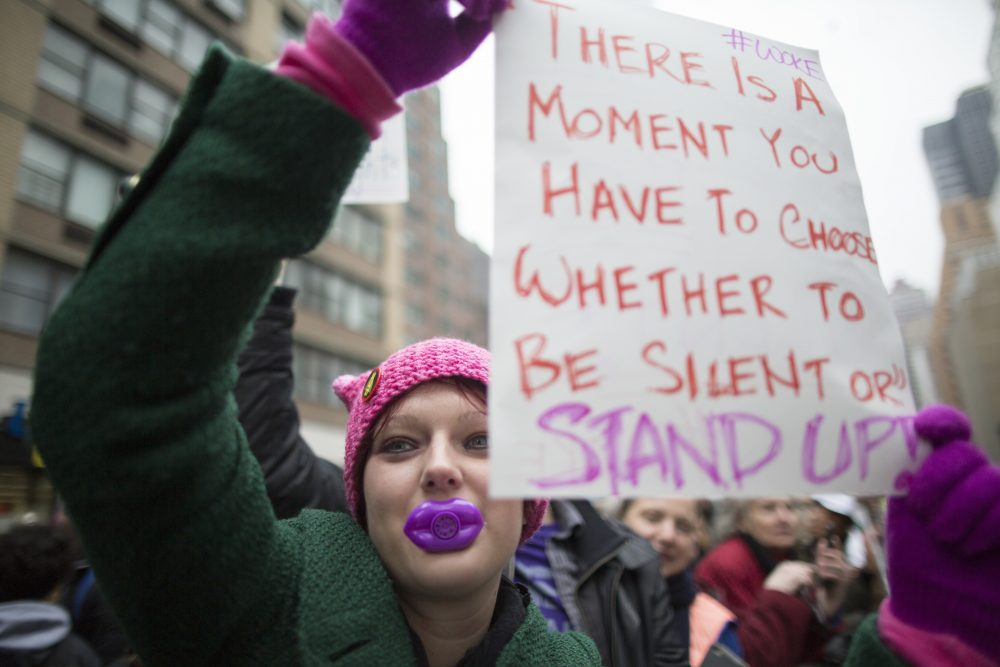 Teen Vogue is tapping into a more outward-looking set of aspirations and concerns among a generation far more worldly than the one that read their mothers' Vogue, writes Julie Wittes Schlack. Pictured here: Suzie McCarthy of Jersey City, N.J., participates in a women's march in New York, Saturday, Jan. 21, 2017.  (Mary Altaffer/AP)
