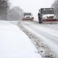 Snow plows on Memorial Drive in Cambridge. (Robin Lubbock/WBUR)