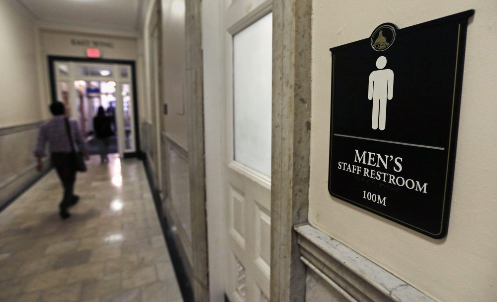 A sign for a men's bathroom at the Massachusetts Statehouse in Boston. (Charles Krupa/AP)