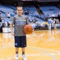Asher Lucas on the court at the Dean Smith Center. (John Lyon)