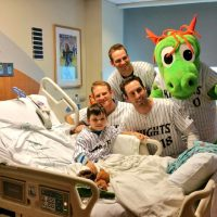 Several Charlotte Knights players and the team's mascot came to visit James David in the hospital after he was hit in the head by a line drive during a game in May 2016. (Charlotte Knights)