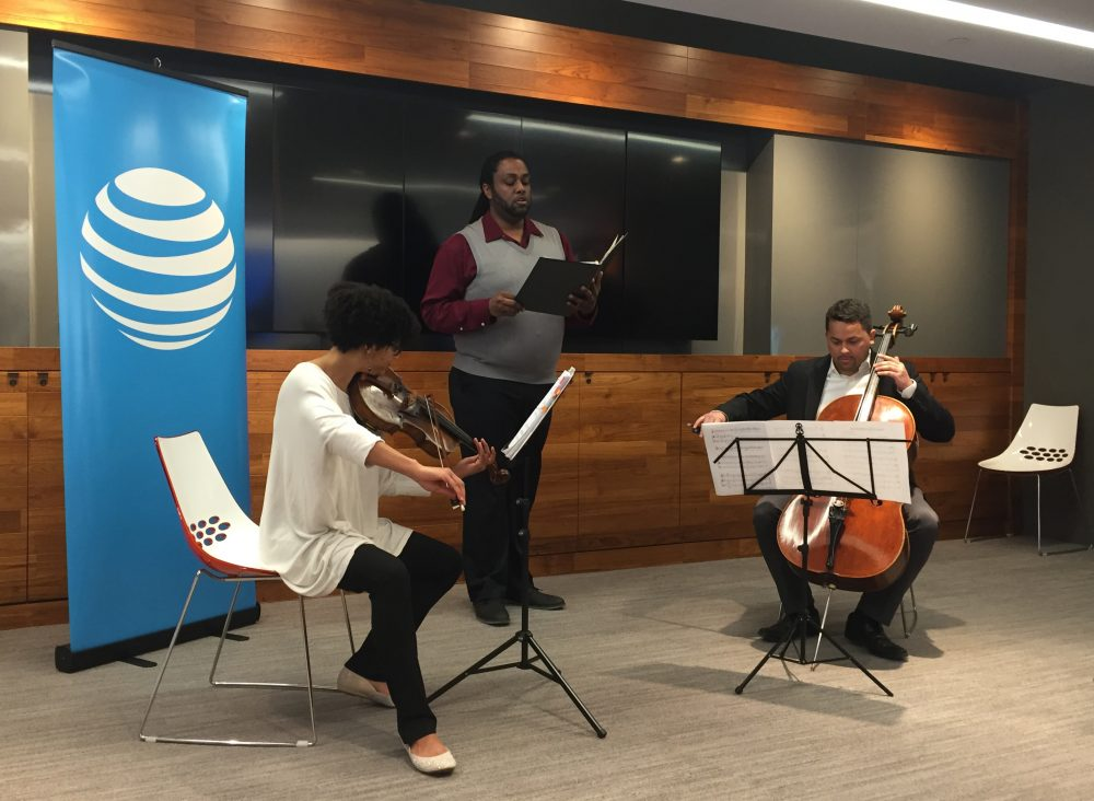 Castle of our Skins members Ashleigh Gordon, Fred VanNess and Javier Caballero perform at the AT&T space in Boston. (Amelia Mason/WBUR)