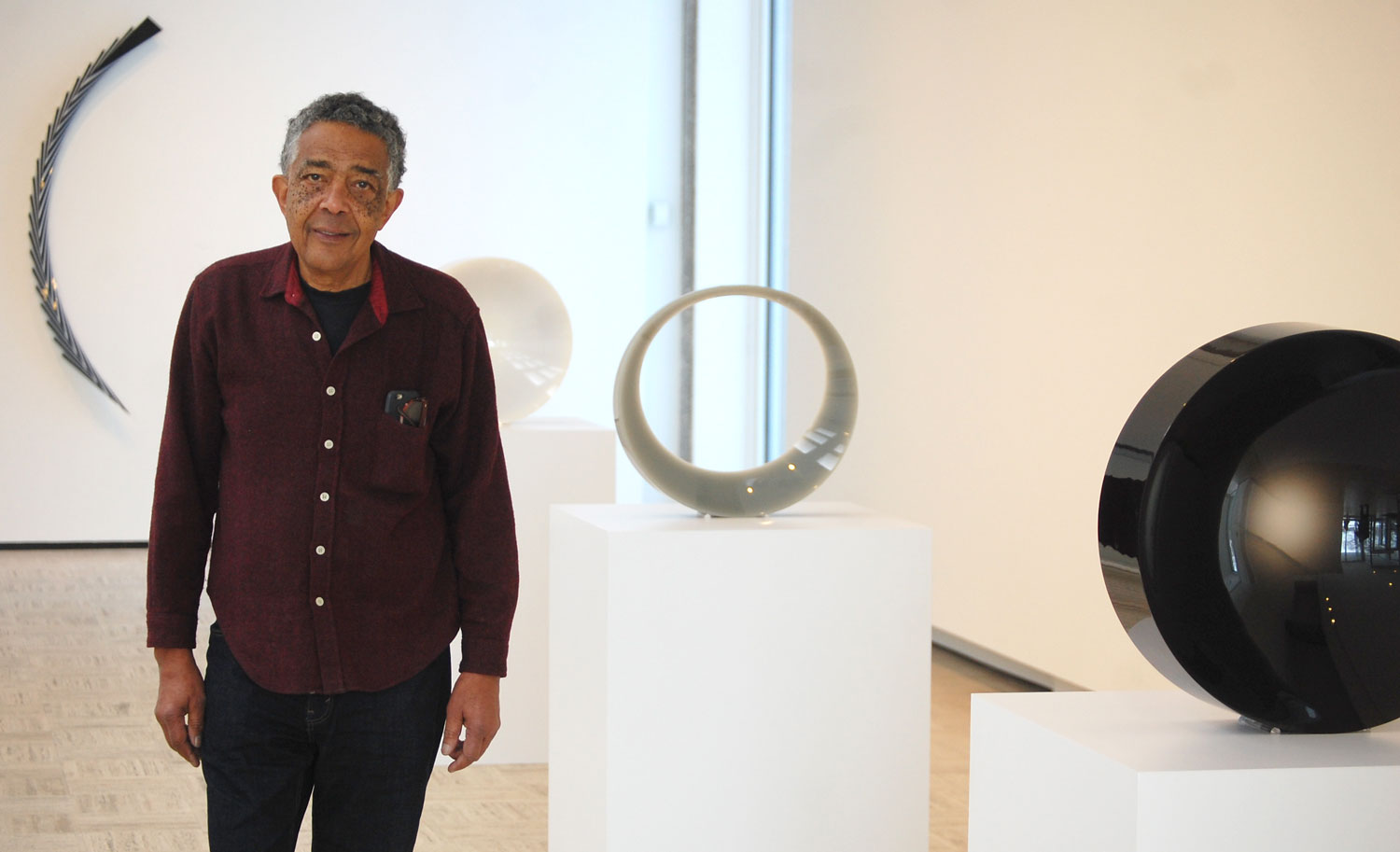"Fred Eversely at his exhibit ""Black, White, Gray"" at Brandeis University's Rose Art Museum. (Greg Cook/WBUR)"