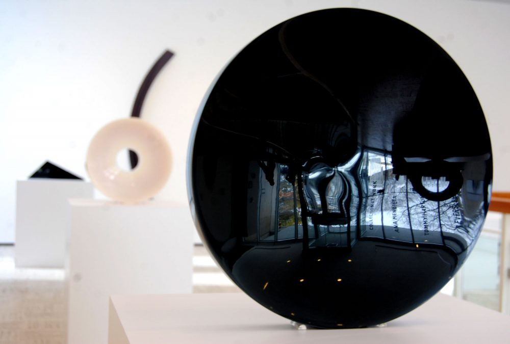 "Fred Eversley's untitled 1974 cast polyester resin lens (right) in the exhibit ""Black, White, Gray,"" an exhibition at Brandeis University's Rose Art Museum. (Greg Cook/WBUR)"
