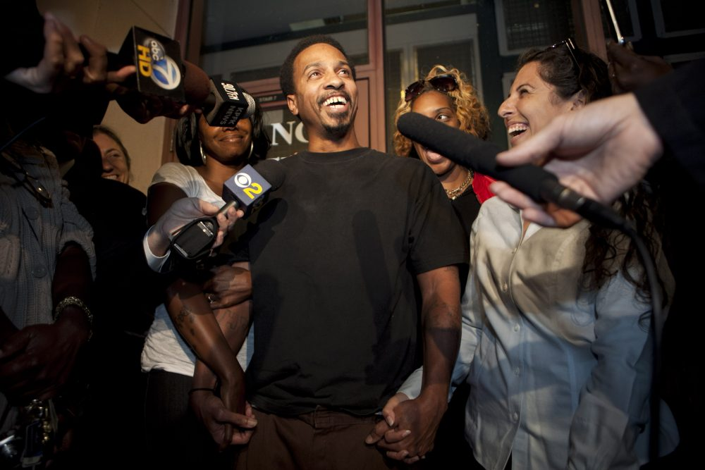Obie Anthony, center, whose murder conviction was overturned after 17 years behind bars, talks to reporters as he is joined by family members and supporters after he was released from the prison in Los Angeles, Tuesday, Oct. 4, 2011. (Damian Dovarganes/AP)