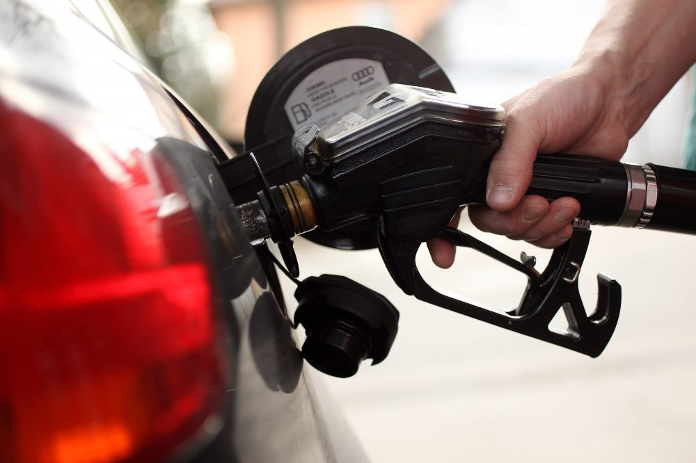 A gasoline station attendant pumps diesel into a car at a filling station on March 23, 2010 in Berlin, Germany. (Sean Gallup/Getty Images)