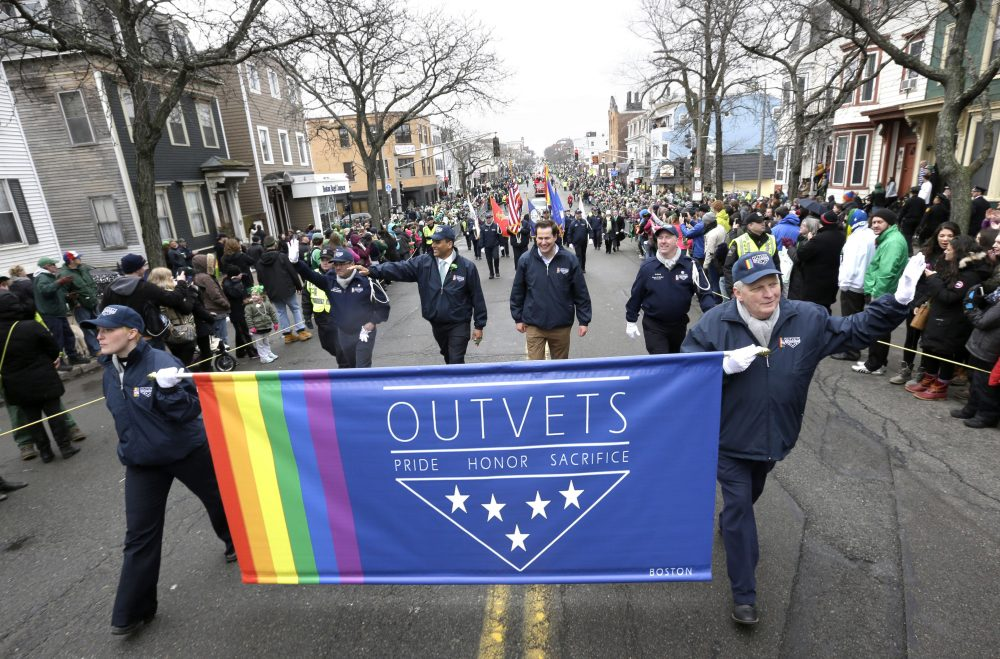 U.S. Rep. Seth Moulton, D-Mass., center without hat, marches with members of OutVets during the 2015 St. Patrick's Day parade in Boston's South Boston neighborhood. (Steven Senne/AP)