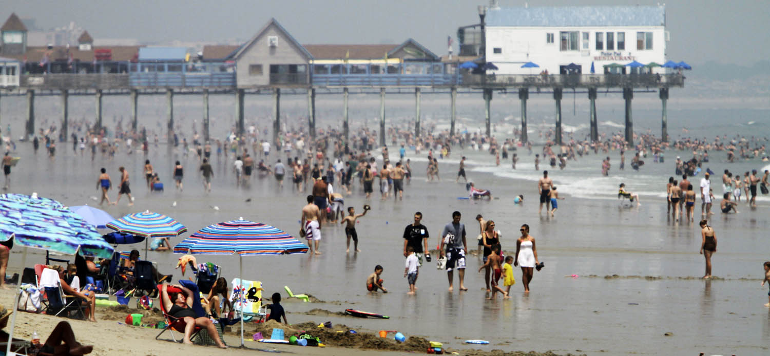 Beach enthusiasts cool off in the ocean at Old Orchard Beach in Maine. (Pat Wellenbach/AP)