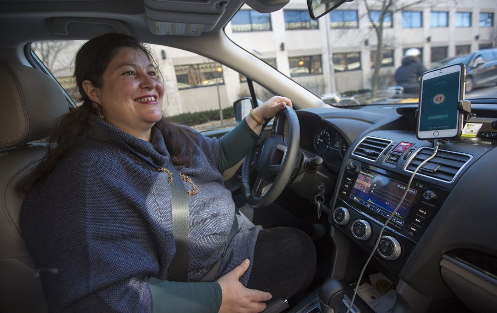 Morgane Matthews drives for Safr, a ride-hailing company that focuses on attracting women drivers and riders. The service recently launched in Boston. (Jesse Costa/WBUR)