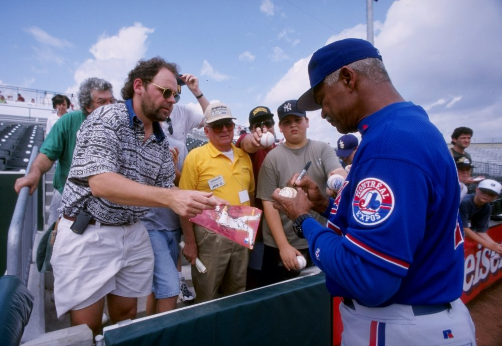 Former Expos manager Felipe Alou signs autographs during spring training in 1998. (Matthew Stockman/Getty Images)