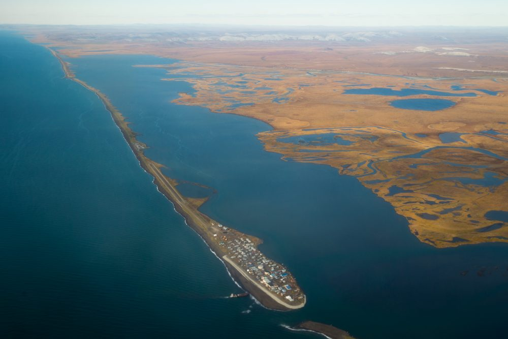 This aerial photo shows the island village of Kivalina, an Alaska Native community of 400 people already receding into the ocean as a result of rising sea levels, in September 2015, in Kotzebue, Alaska. (Andrew Harnik/AP)