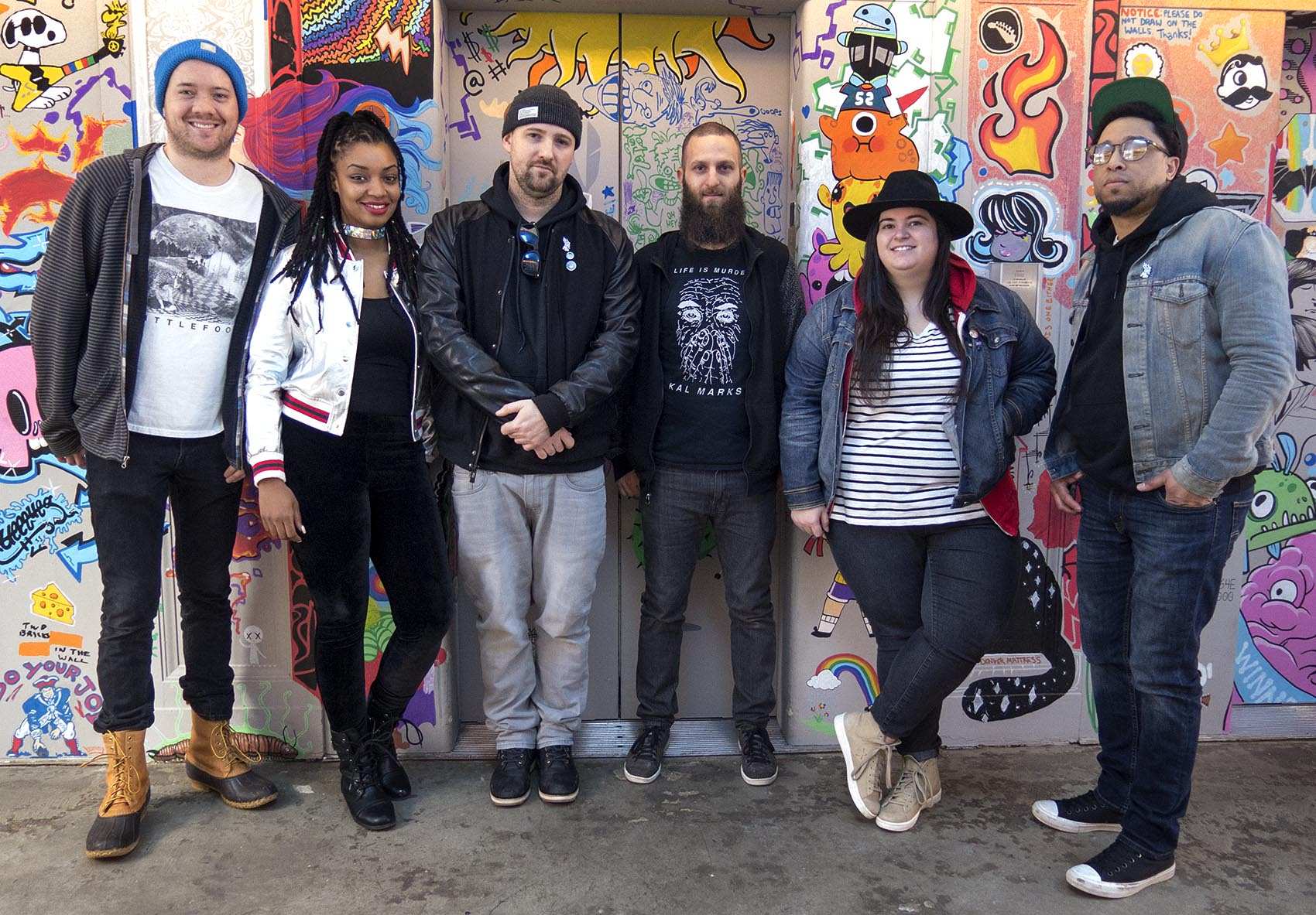 """At """"Rock Band"""" developer Harmonix's offices, from left to right: The Record Company's co-founder Matt McArthur, rapper Dutch ReBelle, producer The Arcitype, The Record Company's Program Director Jesse Vengrove, soul-blues singer Julie Rhodes and rapper Moe Pope. (Andrea Shea/WBUR)"""