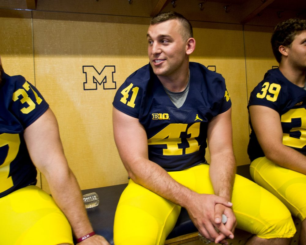 An autoimmune disease kept Michael Hirsch from suiting up for Harvard...so he ended up playing for Michigan. (Tony Ding/AP)