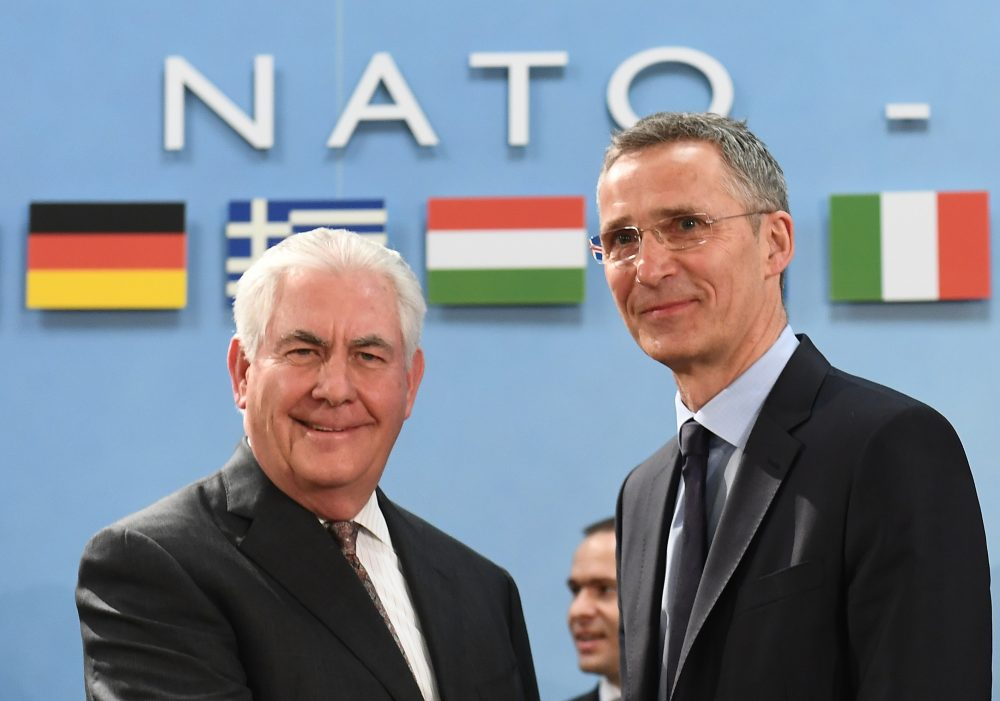 NATO Secretary General Jens Stoltenberg (right) greets Secretary of State Rex Tillerson upon his arrival for a North Atlantic Council (NAC) meeting at the level of Foreign Ministers, at NATO headquarters in Brussels on March 31, 2017. (Emmanuel Dunand/AFP/Getty Images)
