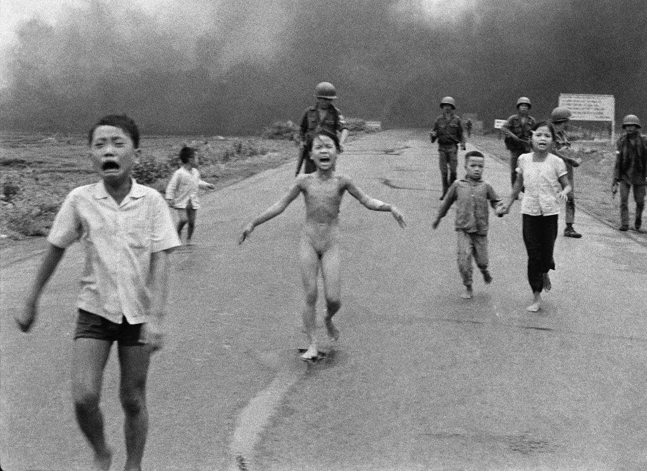 Severely burned in an aerial napalm attack, children run screaming for help down Route 1 near Trang Bang, followed by soldiers of the South Vietnamese army's 25th Division, June 8, 1972. (Nick Ut/AP) 1973 Pulitzer Prize winner for Spot News Photography