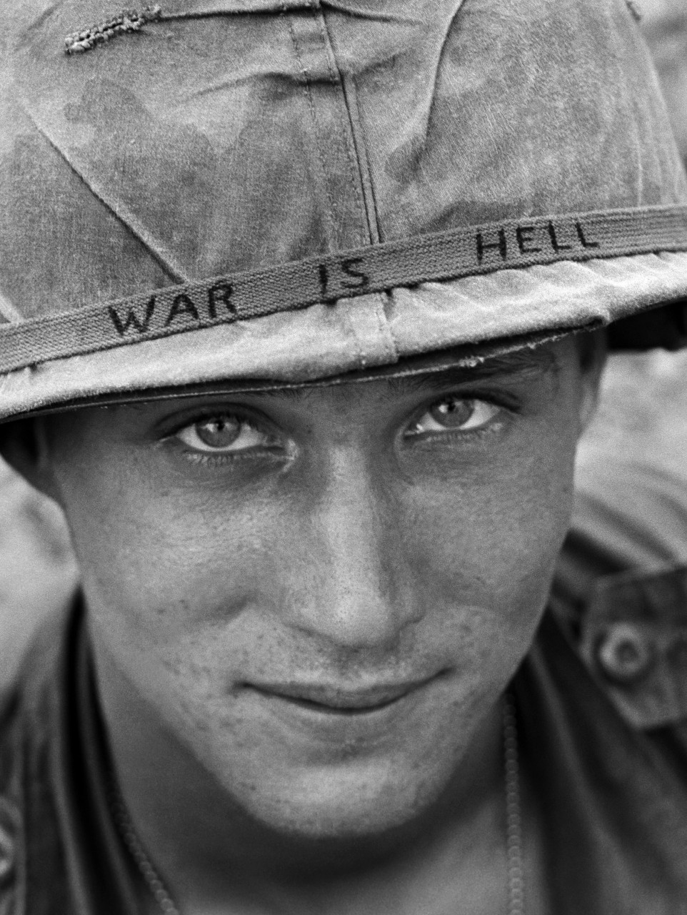 An unidentified American soldier wears a hand-lettered slogan on his helmet, June 1965. The soldier was serving with the 173rd Airborne Brigade on defense duty at the Phuoc Vinh airfield. (Horst Faas/AP)