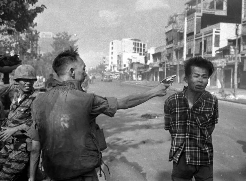"Gen. Nguyen Ngoc Loan, South Vietnamese chief of the national police, fires his pistol into the head of suspected Viet Cong official Nguyen Van Lem on a Saigon street early in the Tet Offensive, February 1, 1968. Photographer Eddie Adams reported that after the shooting, Loan approached him and said, ""They killed many of my people, and yours too,"" then walked away. (Eddie Adams/AP)"