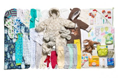 The 2016 Finnish baby box included many outfits, a book, a toy, a toothbrush, a thermometer. Not shown: the cardboard bed. (Photo courtesy Annika Söderblom, ©Kela)