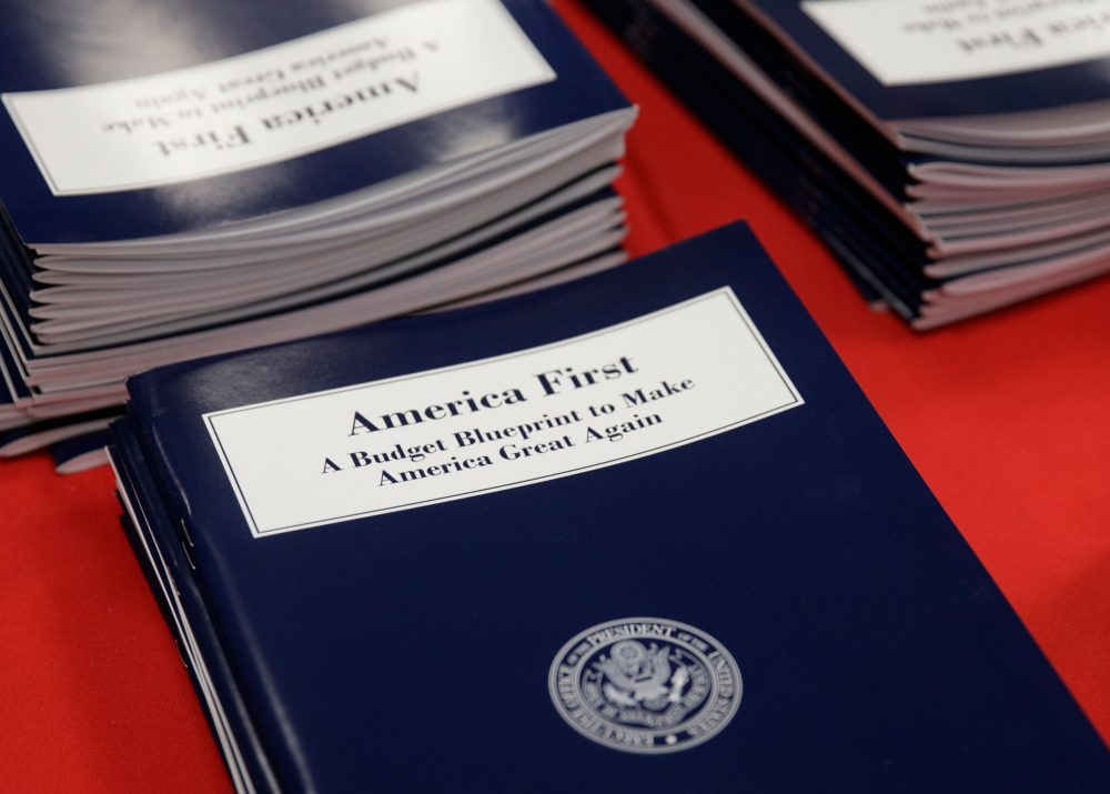 Copies of President Trump's first budget proposal are displayed at the Government Printing Office on Thursday. It's a far-reaching overhaul of federal government spending that slashes many domestic programs to finance a significant increase in the military. (J. Scott Applewhite/AP)