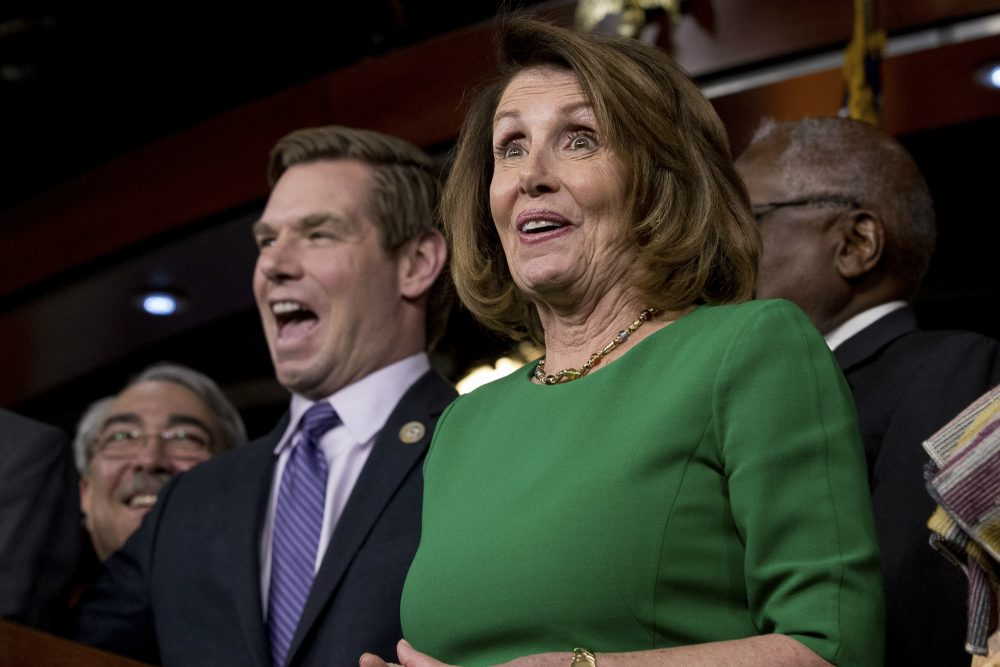 House Minority Leader Nancy Pelosi of Calif., right, accompanied by Rep. G. K. Butterfield, D-N.C., left, and Rep. Eric Swalwell, D-Calif., second from left, joke while speaking at a news conference on Capitol Hill Friday. Republican leaders abruptly pulled their troubled health care overhaul bill off the House floor, short of votes and eager to avoid a humiliating defeat for President Trump and GOP leaders. (Andrew Harnik/AP)