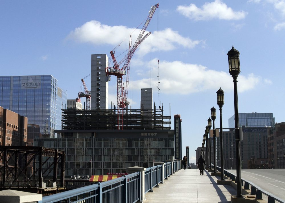 The city needs to stop its giveaway of our waterfront commons and prioritize public space over private greed, writes Bradley Campbell. Pictured: Construction takes place in the Seaport District on Jan. 14, 2016. Boston's Seaport District long was filled with docks, warehouses and parking lots. But in recent years it has become the city's hottest and fastest-growing neighborhood. (Bill Sikes/AP)