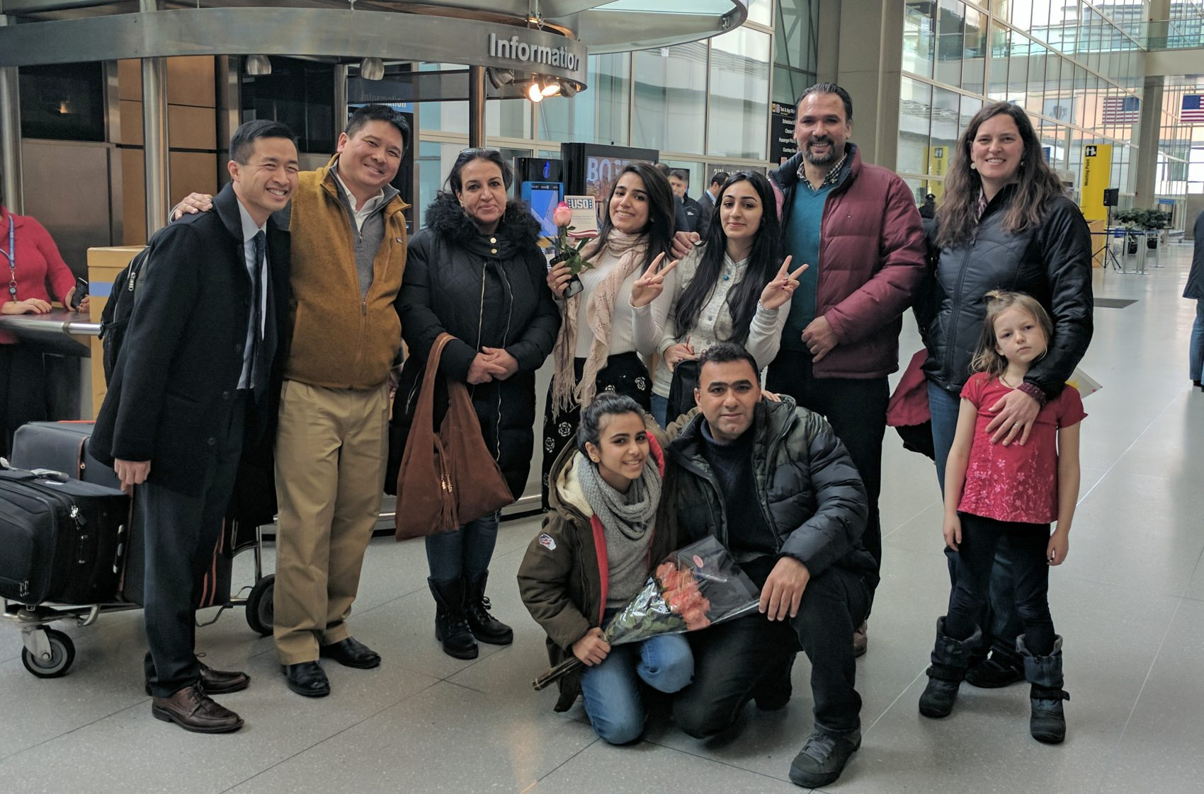 Banah Al-Hanfy, third from right, at Logan International Airport with her family and the Maine residents who helped reunite them. (Courtesy of Brian Eng)