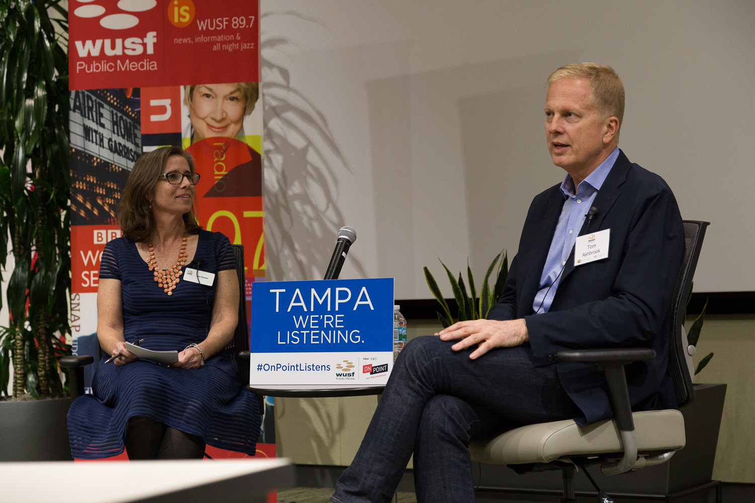 Mary Shedden, news director at member station WUSF, talks with On Point host Tom Ashbrook at the #OnPointListens event in Tampa, FL. (Stephen Glass/WUSF)