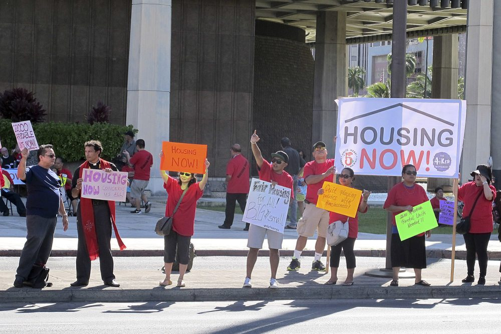 In this April 21, 2016 photo, affordable housing and homeless advocates rally outside the state capitol in Honolulu.Hawaii. (Cathy Bussewitz/AP)