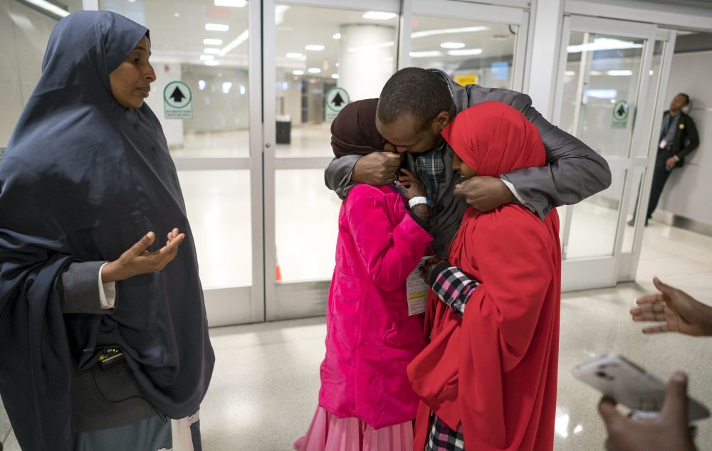 As a forensic psychiatrist with expertise in violence risk assessment, writes Dr. Reena Kapoor, I can assure you that perfect system isn't coming anytime soon, if ever. Pictured here: Ismail Issack embraces his children as they reunite for the first time in seven years at John F. Kennedy International Airport in New York Wednesday, March 8, 2017. The parents, were originally scheduled to receive the children earlier this year, but the process was delayed due to a security check expiring as a result of delayed travel caused by the January executive order of the travel ban by President Donald Trump. (Craig Ruttle/AP)