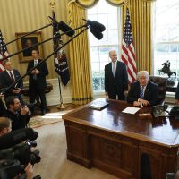President Donald Trump, flanked by Health and Human Services Secretary Tom Price, left, and Vice President Mike Pence, meets with members of the media regarding the health care overhaul bill. (Pablo Martinez Monsivais/AP)