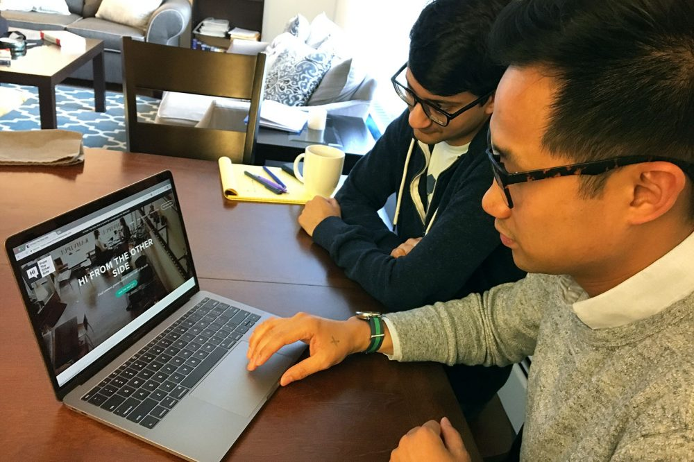Henry Tsai (front) and Yasyf Mohamedali created Hi From The Other Side, a website that connects people with opposing political views online and then gets them to meet in real life. (Asma Khalid/WBUR)