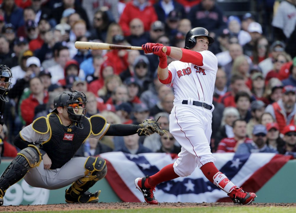 The Boston Red Sox's Andrew Benintendi hits a three-run homer in front of Pittsburgh Pirates catcher Francisco Cervelli during the fifth inning at Fenway Park Monday. (Elise Amendola/AP)
