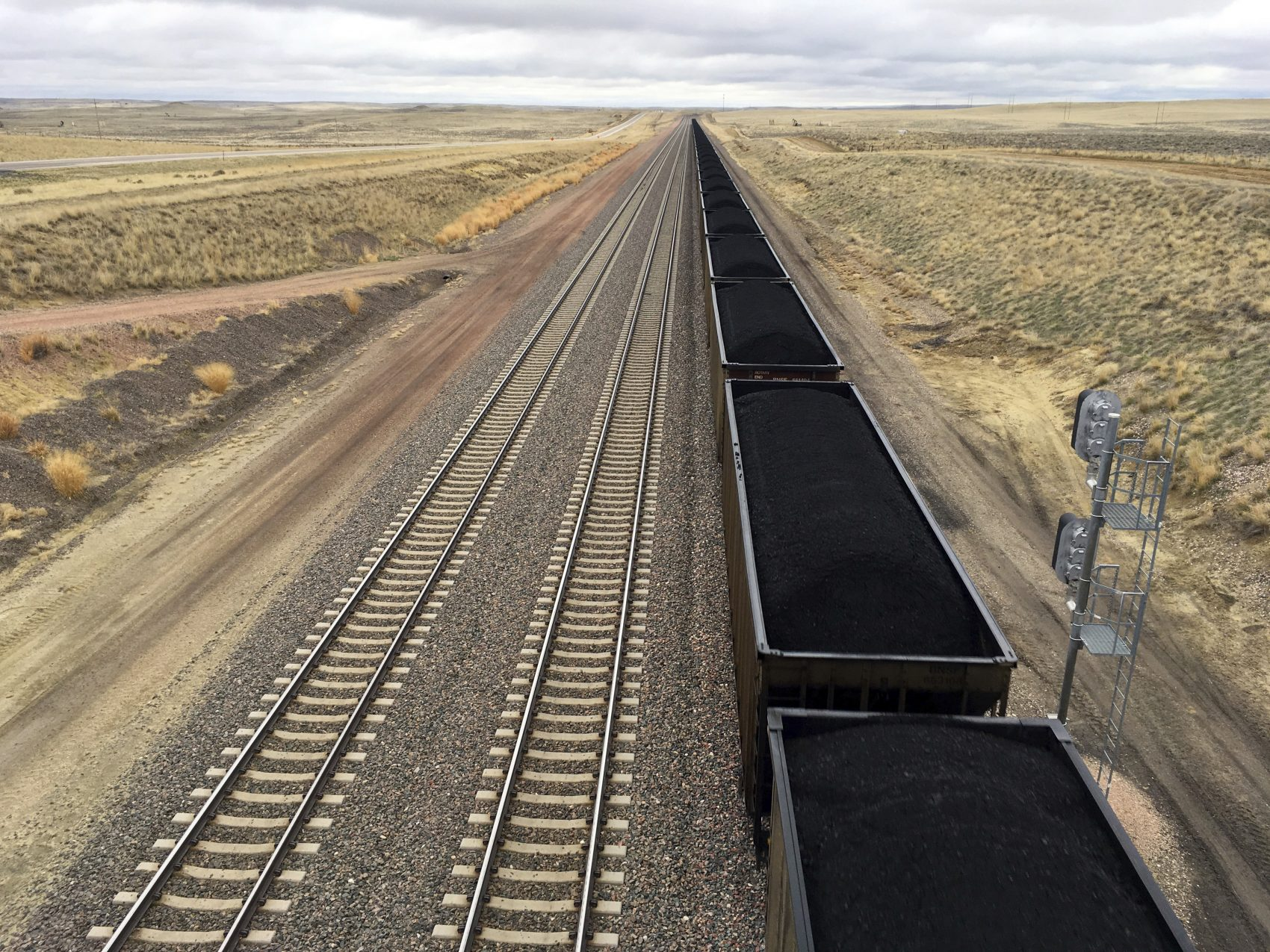 A train near hauls coal mined from Wyoming's Powder River Basin near Bill, Wyo., Tuesday, March 28, 2017. President Donald Trump's lifting of a federal coal leasing moratorium issued last year by President Barack Obama will allow new leasing of federal coal to resume in the basin and elsewhere. (Mead Gruver/AP)