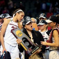 Dawn Staley holds the NCAA trophy after South Carolina's victory over Mississippi State.  (Ron Jenkins/Getty Images)