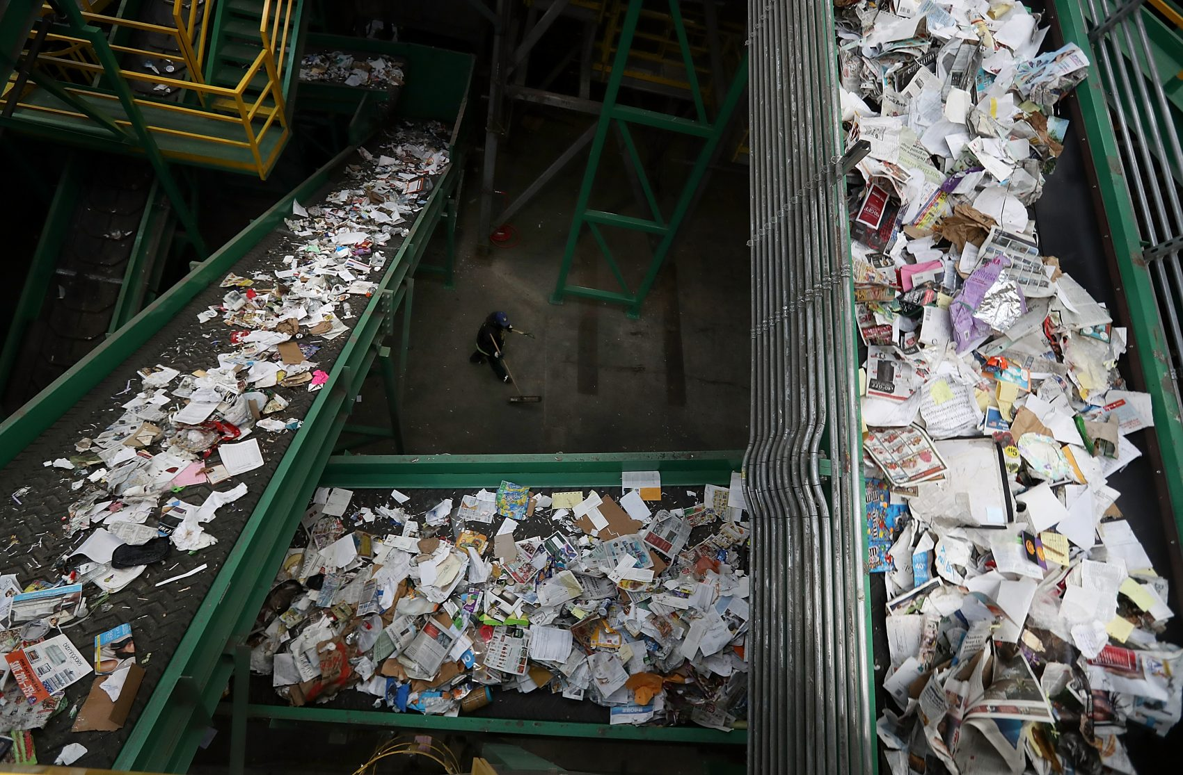 Conveyor belts carry recyclable materials through a sorting machine at Recology's Recycle Central in San Francisco. (Justin Sullivan/Getty Images)