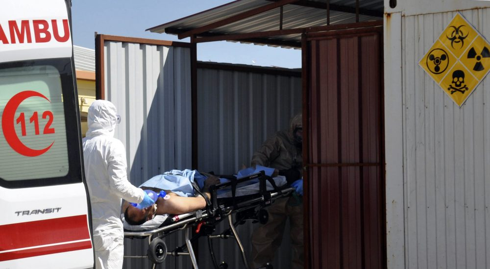Turkish experts evacuate a victim of a suspected chemical weapons attacks in the Syrian city of Idlib, at a local hospital in Reyhanli, Turkey, Tuesday, April 4, 2017. A suspected chemical attack in a town in Syria's rebel-held northern Idlib province killed dozens of people on Tuesday, opposition activists said, describing the attack as among the worst in the country's six-year civil war. (DHA-Depo Photos via AP)