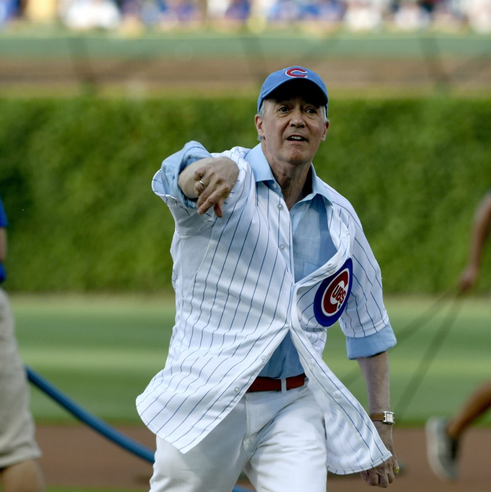 NPR's Scott Simon, a lifelong Cubs fan, throws out the first pitch before a game in 2016. Later that year, the Cubs won their first World Series in 108 years. (Matt Marton/AP)
