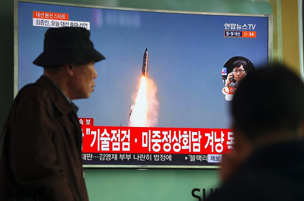 A man walks past a television screen showing file footage of a North Korean missile launch, at a railway station in Seoul on April 5, 2017. (Jung Yeon-Je/AFP/Getty Images)