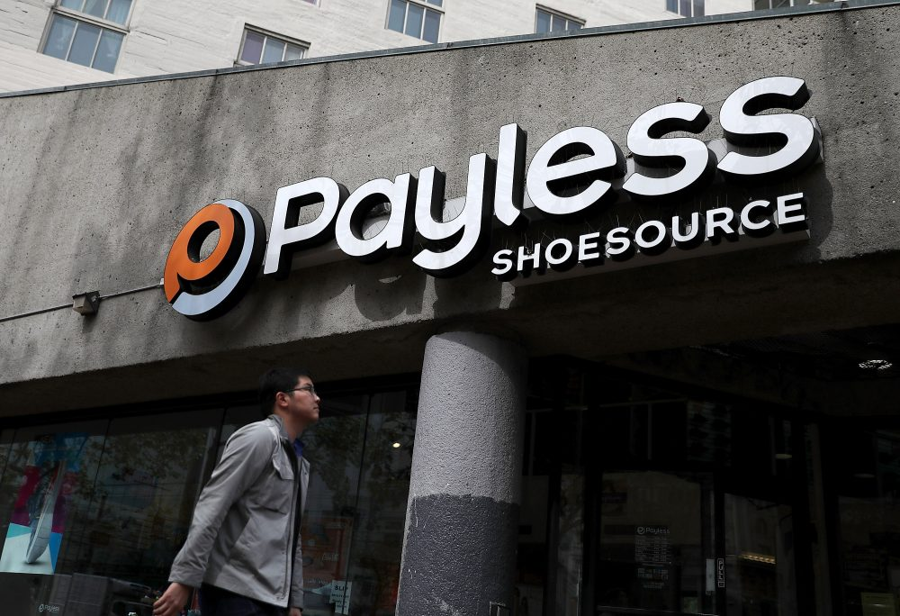 A pedestrian walks by a Payless Shoe Source store on April 5, 2017 in San Francisco. The Kansas-based discount shoe retailer has filed for Chapter 11 bankruptcy and will close nearly 400 of its stores. (Justin Sullivan/Getty Images)