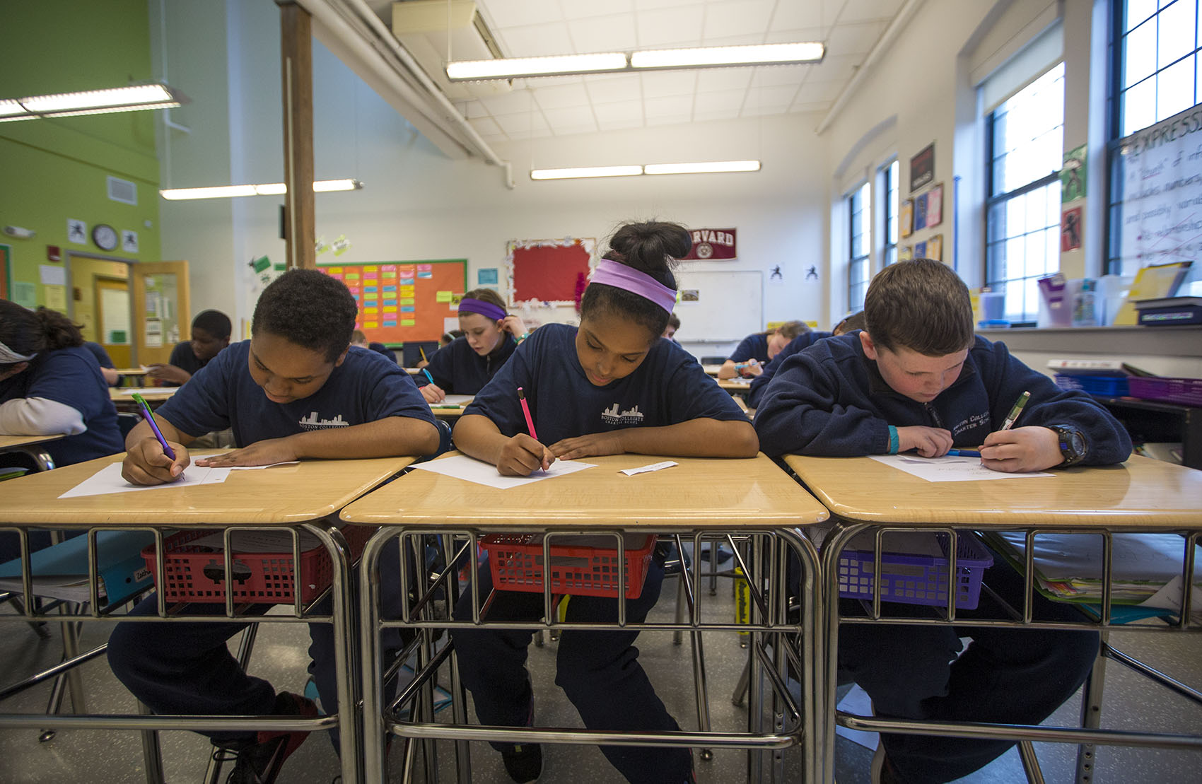 Boston Collegiate Charter School students from Bridget Adam's math class work on a problem involving median, mean and mode. (Jesse Costa/WBUR)