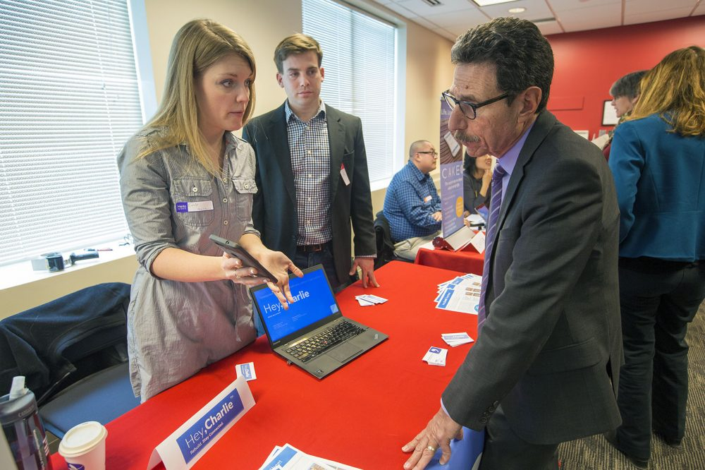 Hey, Charlie co-founders Emily Lindemer and Vincent Valant explain some of the features of their app at the Digital Health Innovation Showcase. (Jesse Costa/WBUR)