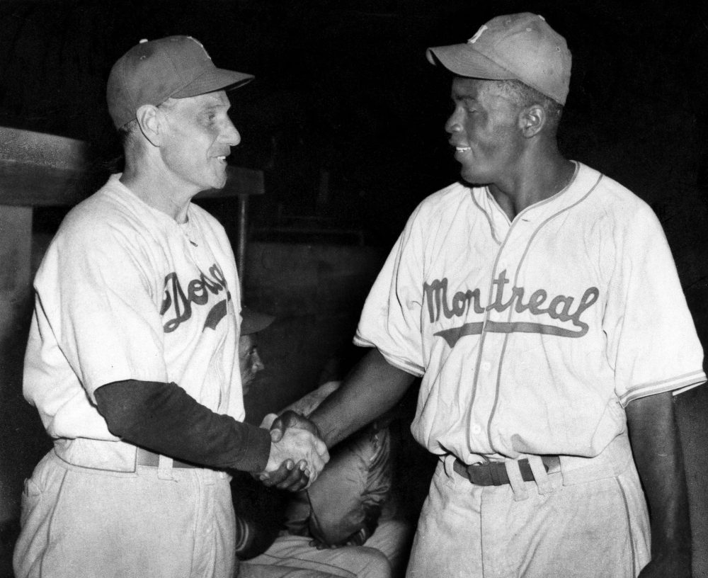 Former Dodgers manager Leo Durocher (left) and Jackie Robinson (right) feuded for decades. (AP)