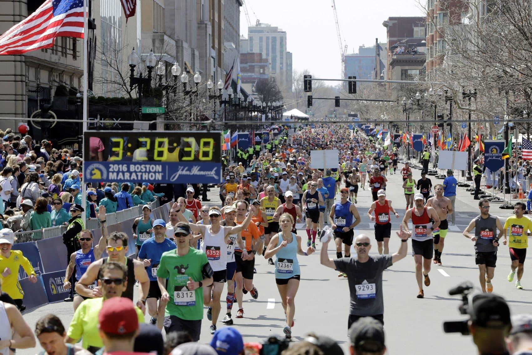 Runners approach the finish line of the 120th Boston Marathon on Monday, April 18, 2016, in Boston. (Elise Amendola/AP Photo)