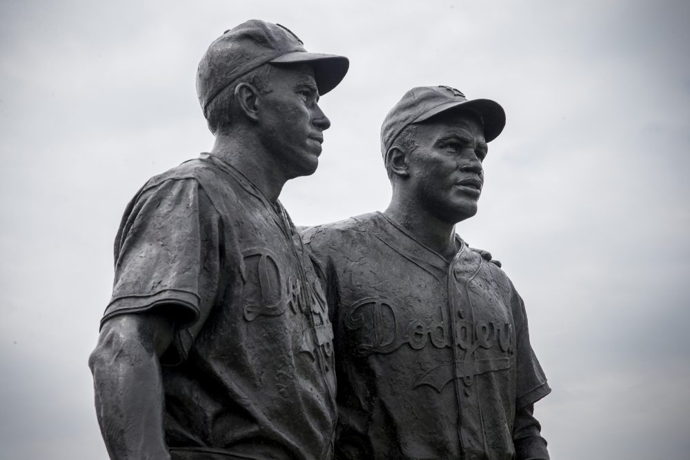 A statue of Jackie Robinson (right) and teammate Pee Wee Reese (left) stands in Brooklyn. According to Dr. Chris Stride, there are more statues for Jackie Robinson than any other U.S. athlete. (Andrew Burton/Getty Images)
